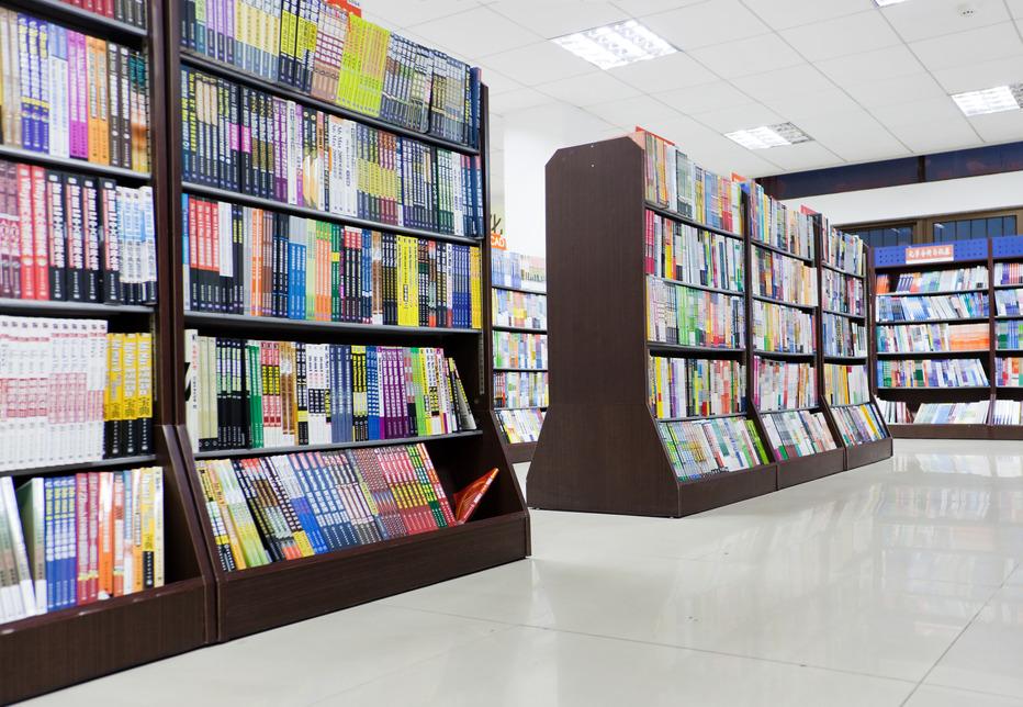 Shelves full of books in a library.