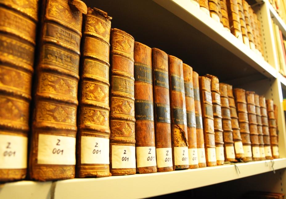 books in a library bookshelf for university education